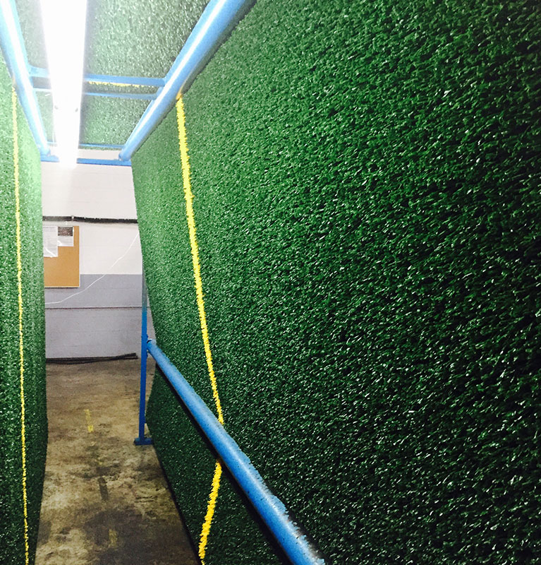 sheet of artificial turf hanging to cure