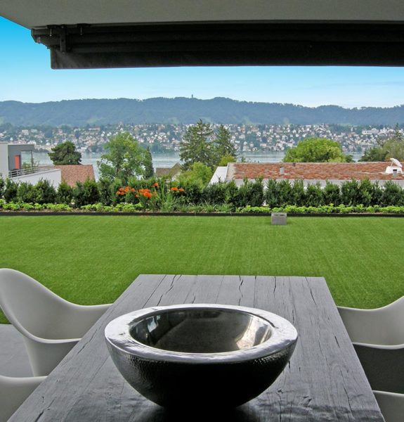 outdoor table overlooking turf lawn
